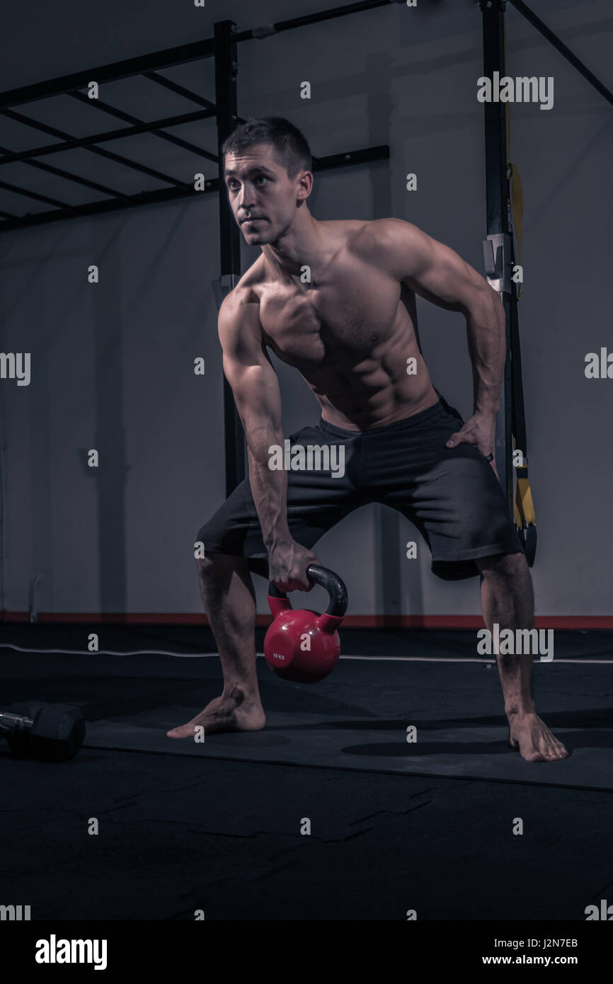 Kettlebell Bodybuilding One Young Adult Man Bodybuilder Flat Bench Kettlebell Swing