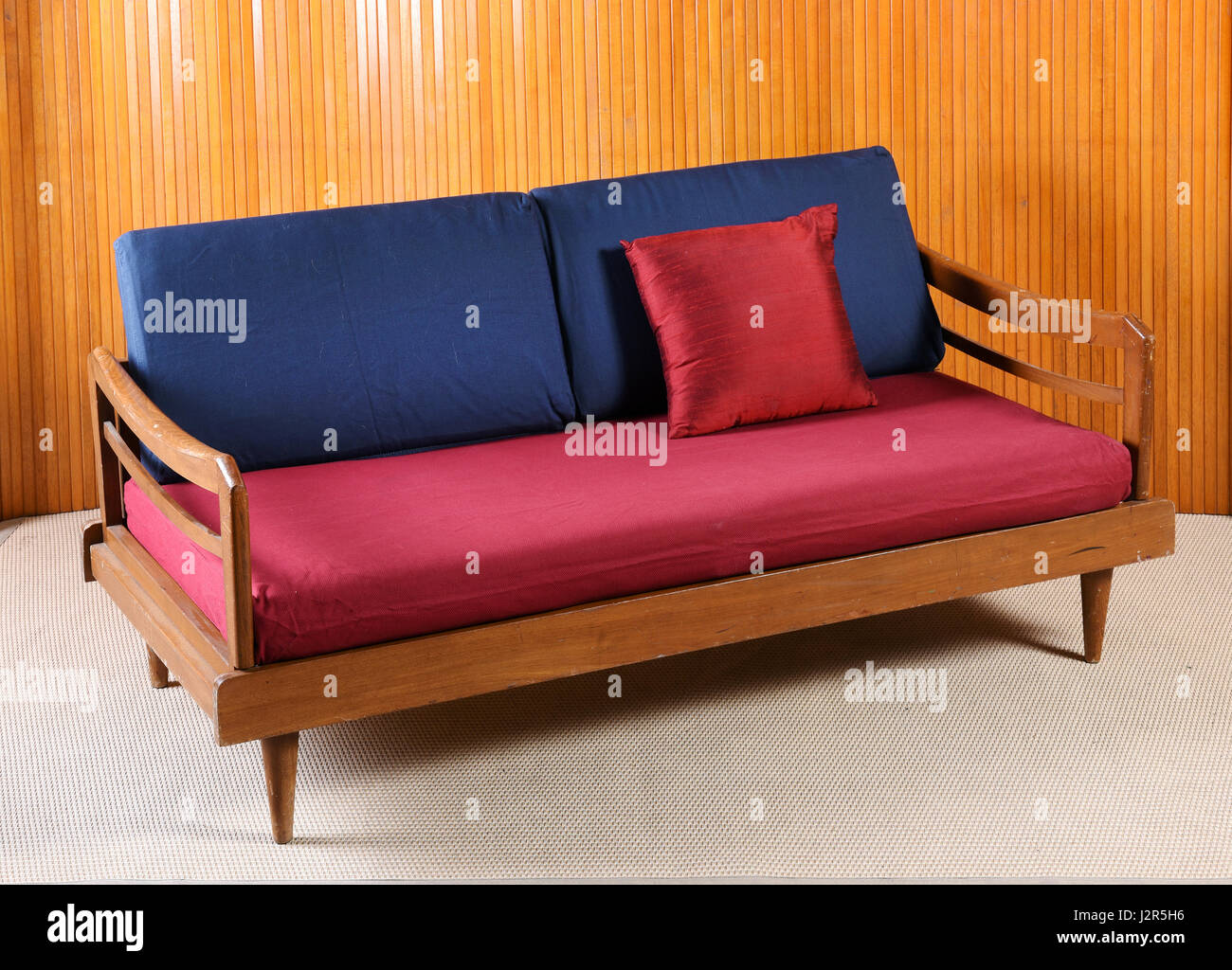Vintage Couch Upholstered Red And Blue Vintage Sofa With A Wooden Frame And