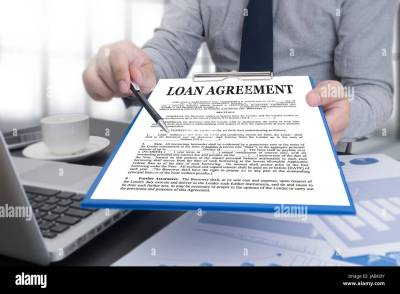 LOAN AGREEMENT Business Support document and agreement signing Stock Photo: 144084415 - Alamy
