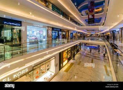 Inside architecture of the shopping center Quest Mall ...