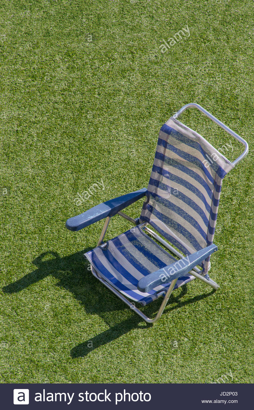 White Plastic Sun Loungers Plastic Sun Lounger In Blue And White Beach Chair On The Grass
