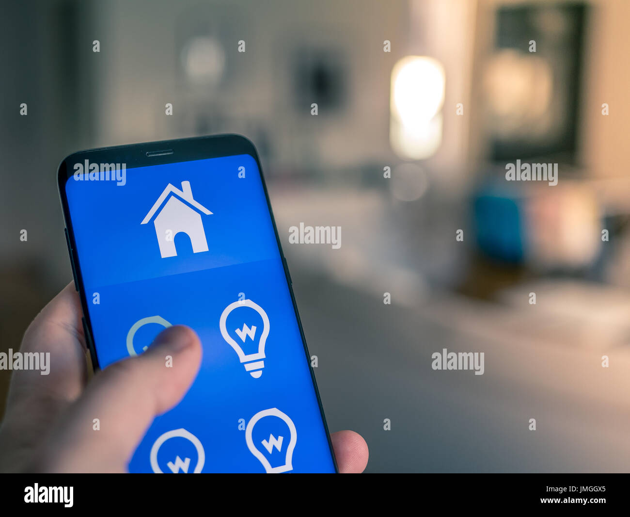 Light Automation Smart Home Automation Mobile Device With Light App Man Uses His