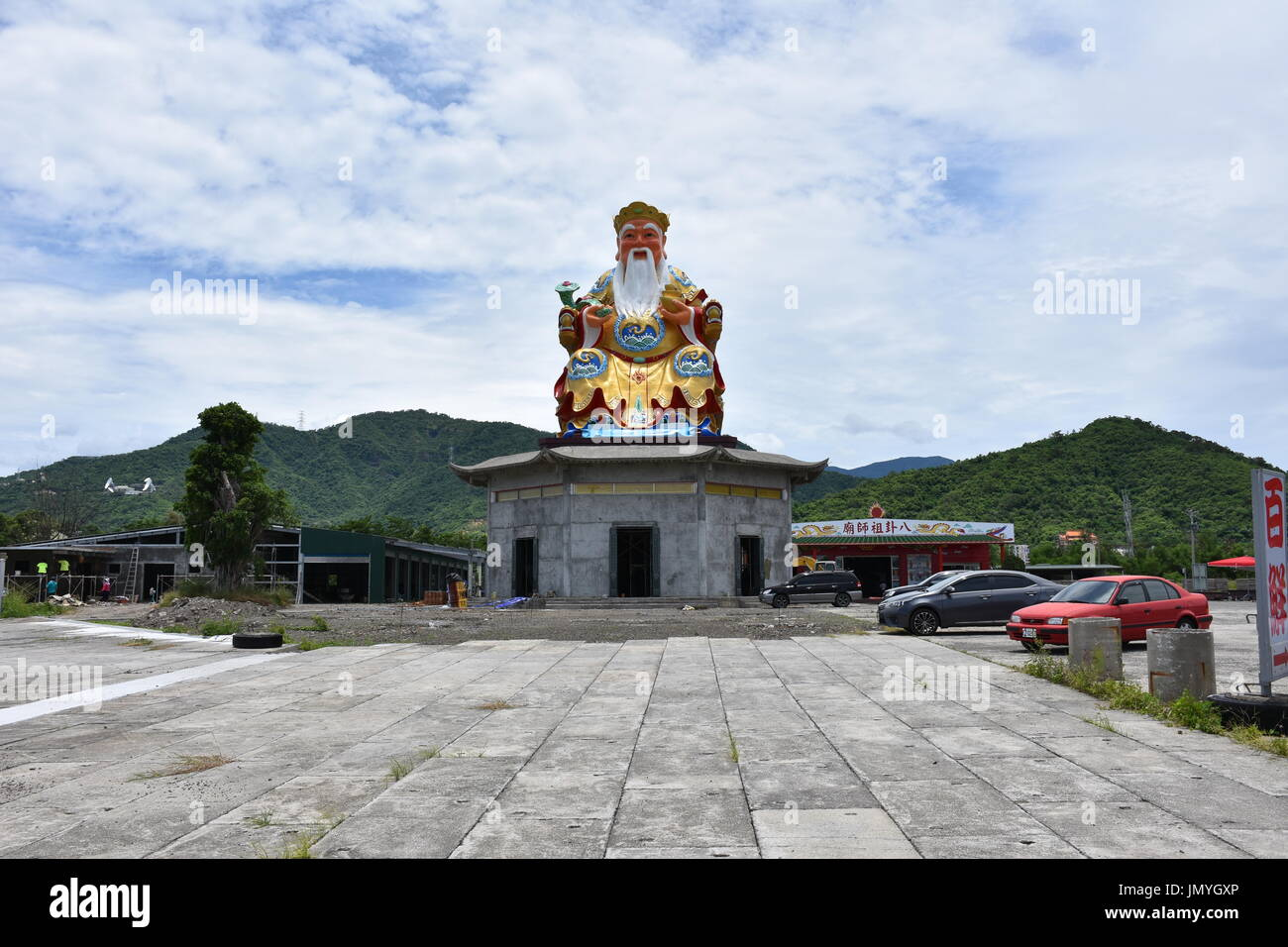 5 5 In Meters A Happy Buddha Statue That Stands Over 5 Meters Tall On Top Of A