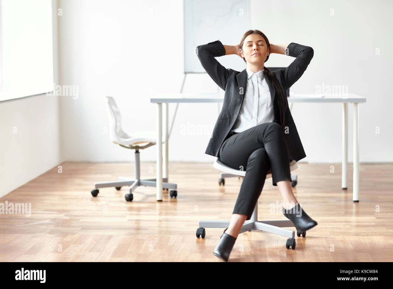 Businesswoman Relaxing Feet On Desk Stock Photos