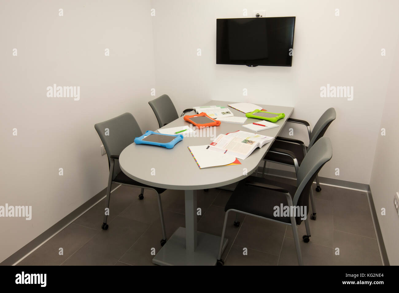 Meeting Room Tables Small Meeting Room With A Single Table With Four Chairs Papers
