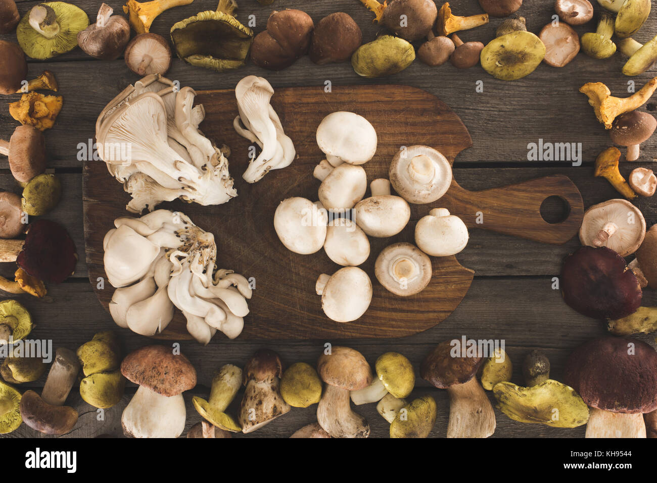 Different Types Of Cutting Boards Brown Mushrooms On Cutting Board Stock Photos And Brown