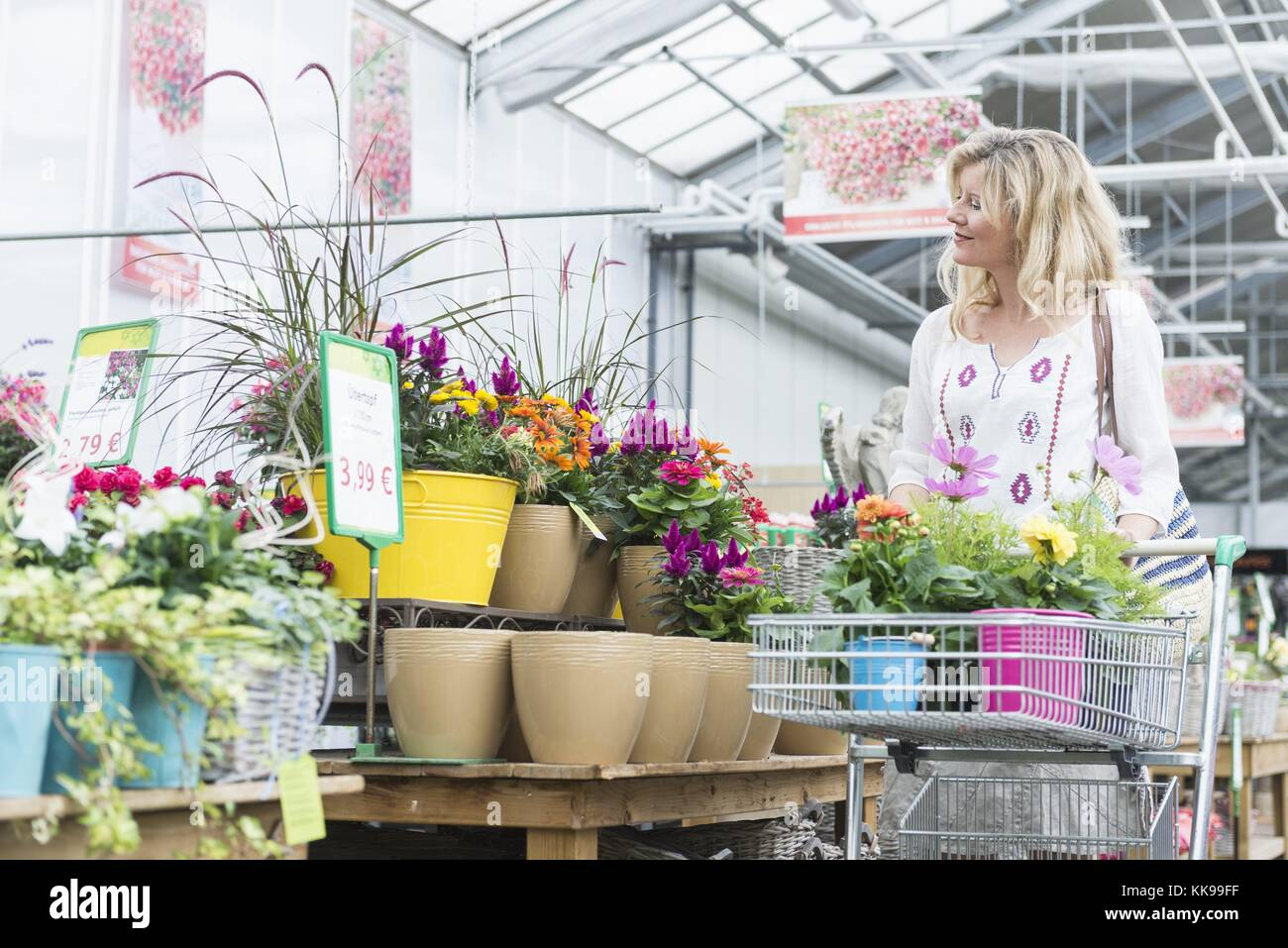 Augsburg Shopping Mature Woman Shopping In Garden Centre Augsburg Bavaria Germany