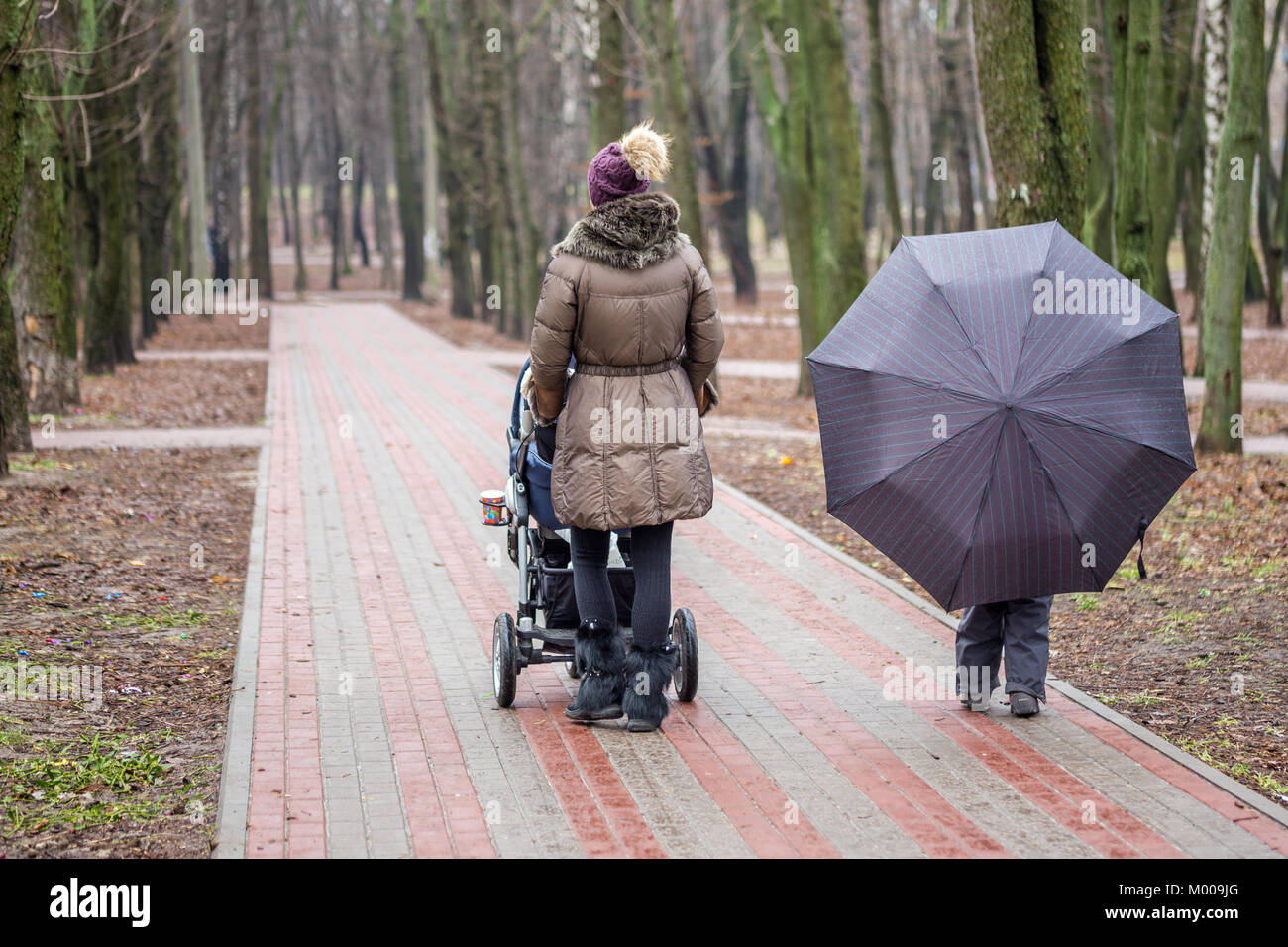 Newborn Umbrella Stroller Mom And Daughter Holding Umbrella And Walking Together With