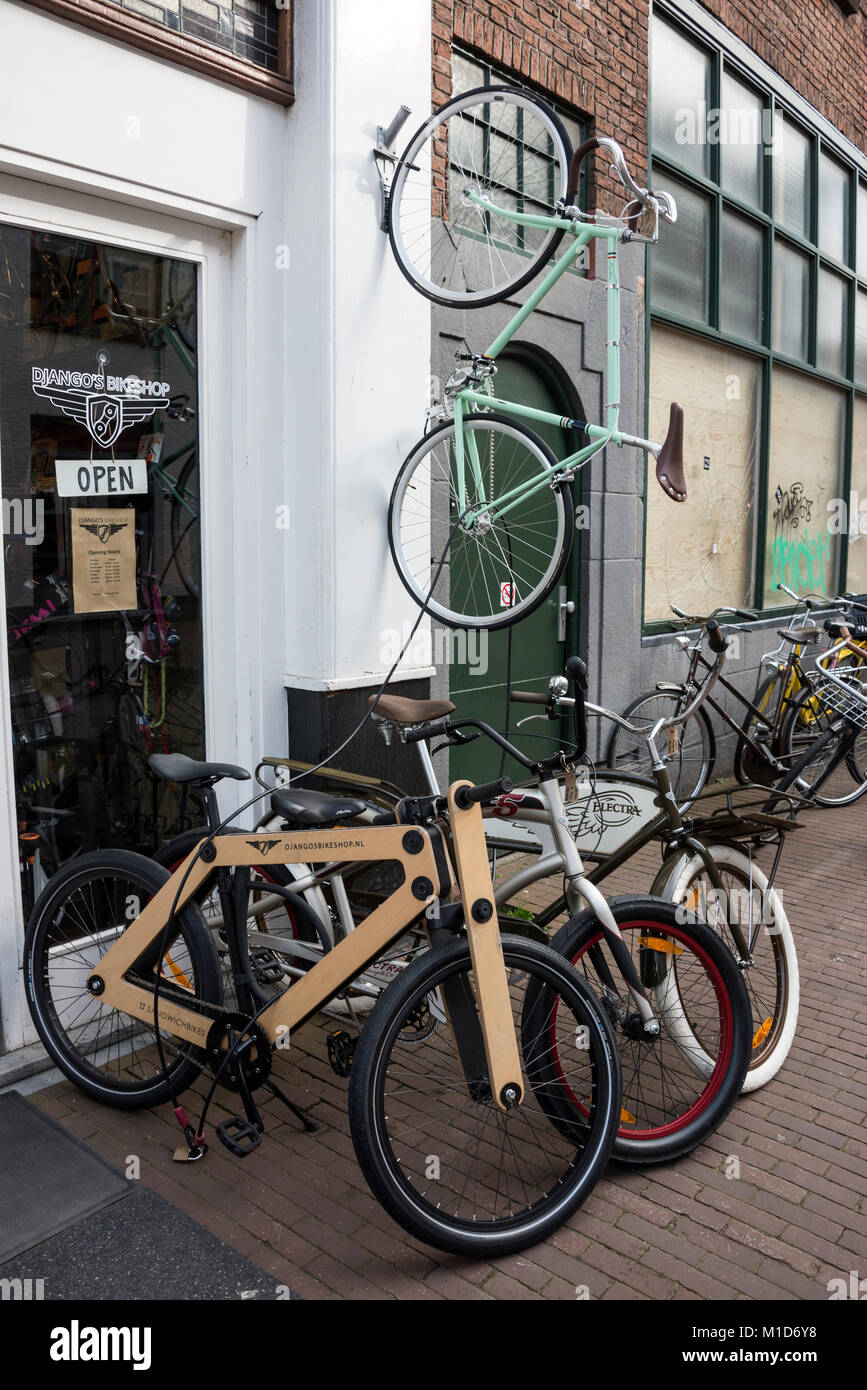 Bike Shop Sale A Bicycle Shop With A Wooden Framed Bicycle On Sale In A Narrow
