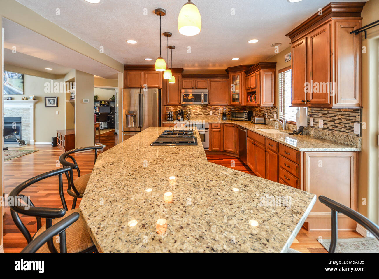 Kitchen Counter And Stools Spacious Upscale Kitchen In A Luxury Home With Large Granite Slab