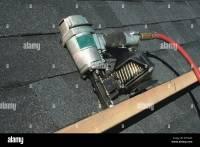 Pneumatic Nail Gun Stock Photos & Pneumatic Nail Gun Stock ...