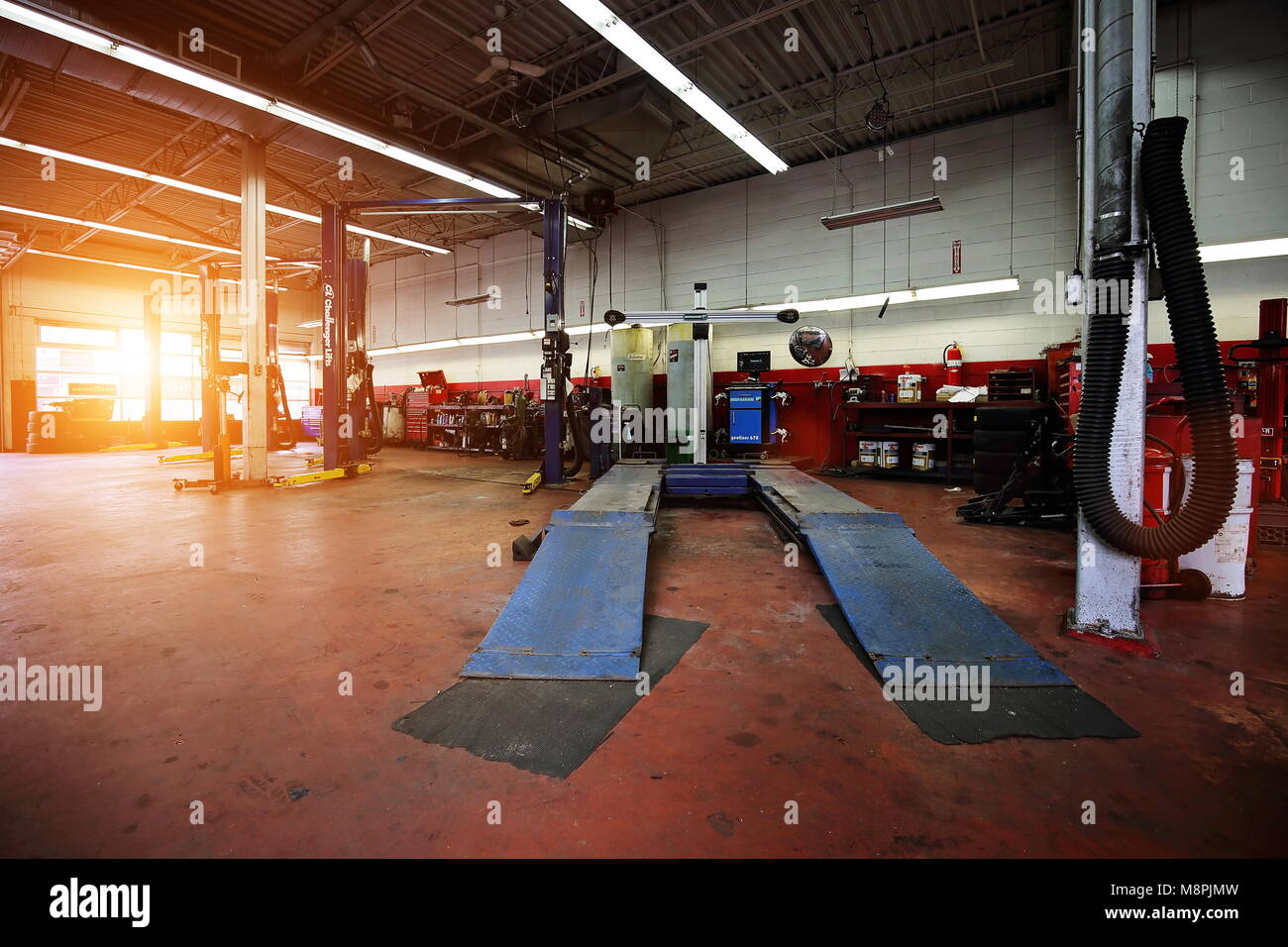 Garage Gym With Car Professional Car Repair Service In Downtown Garage Stock Photo