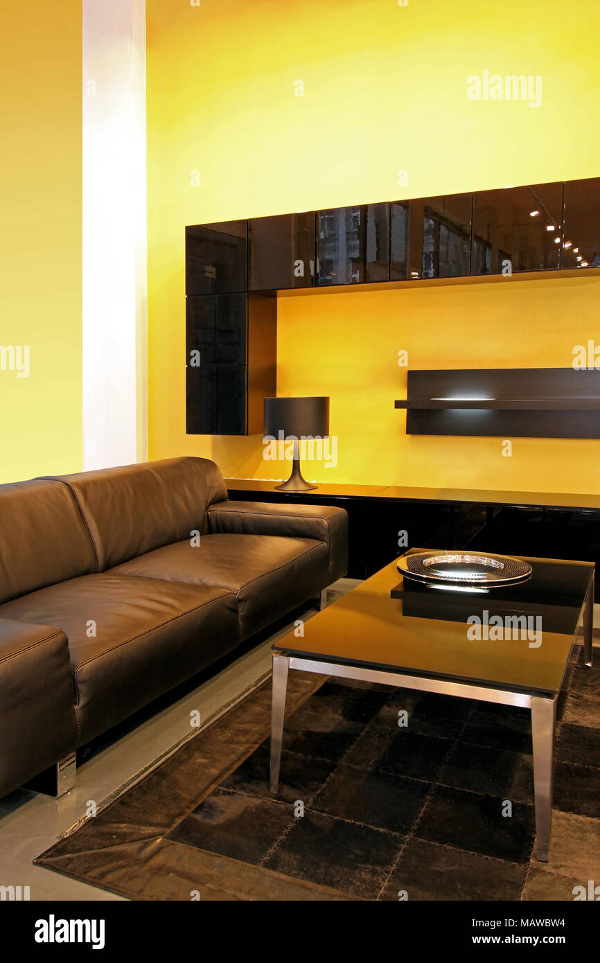 Modern Living Room With Leather Sofa And Yellow Walls Stock Photo Alamy