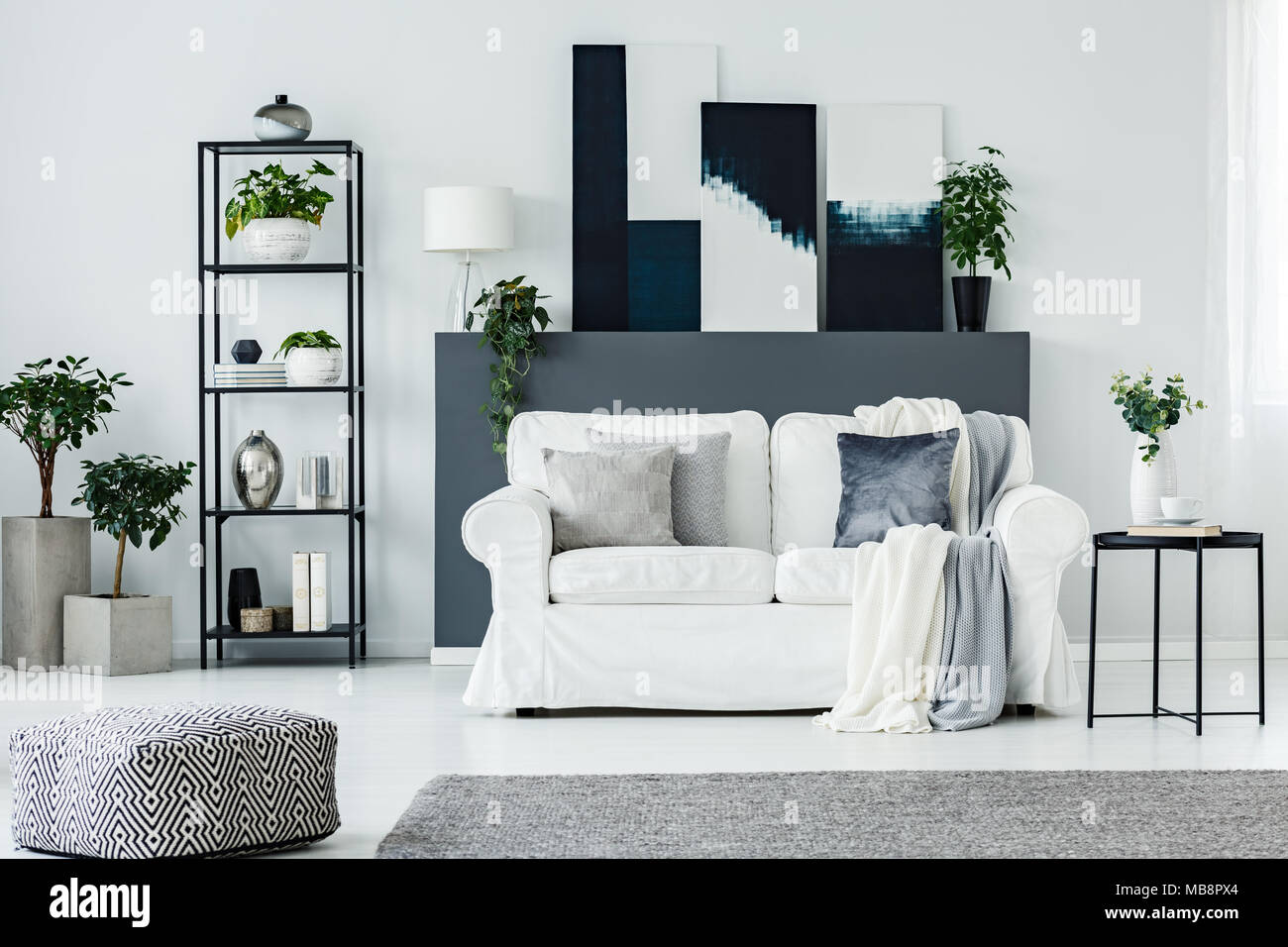 Living Room Paintings Comfortable Sofa By A Gray Wall With Abstract Paintings In A