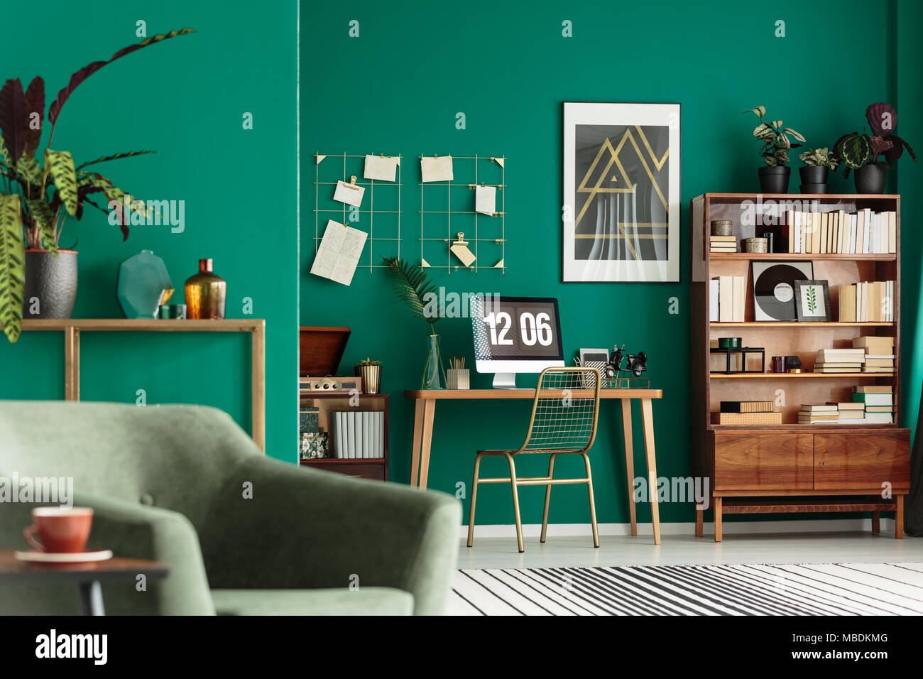 Green Living Green Living Room Interior With Books On Wooden Cupboard And