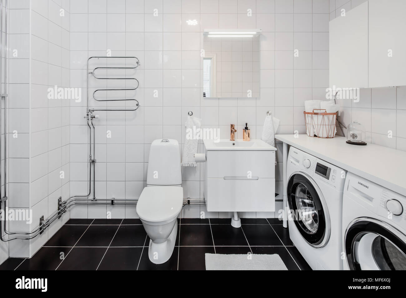Black Tiled Bathroom Black And White Tiled Bathroom With Washing Machines Stock