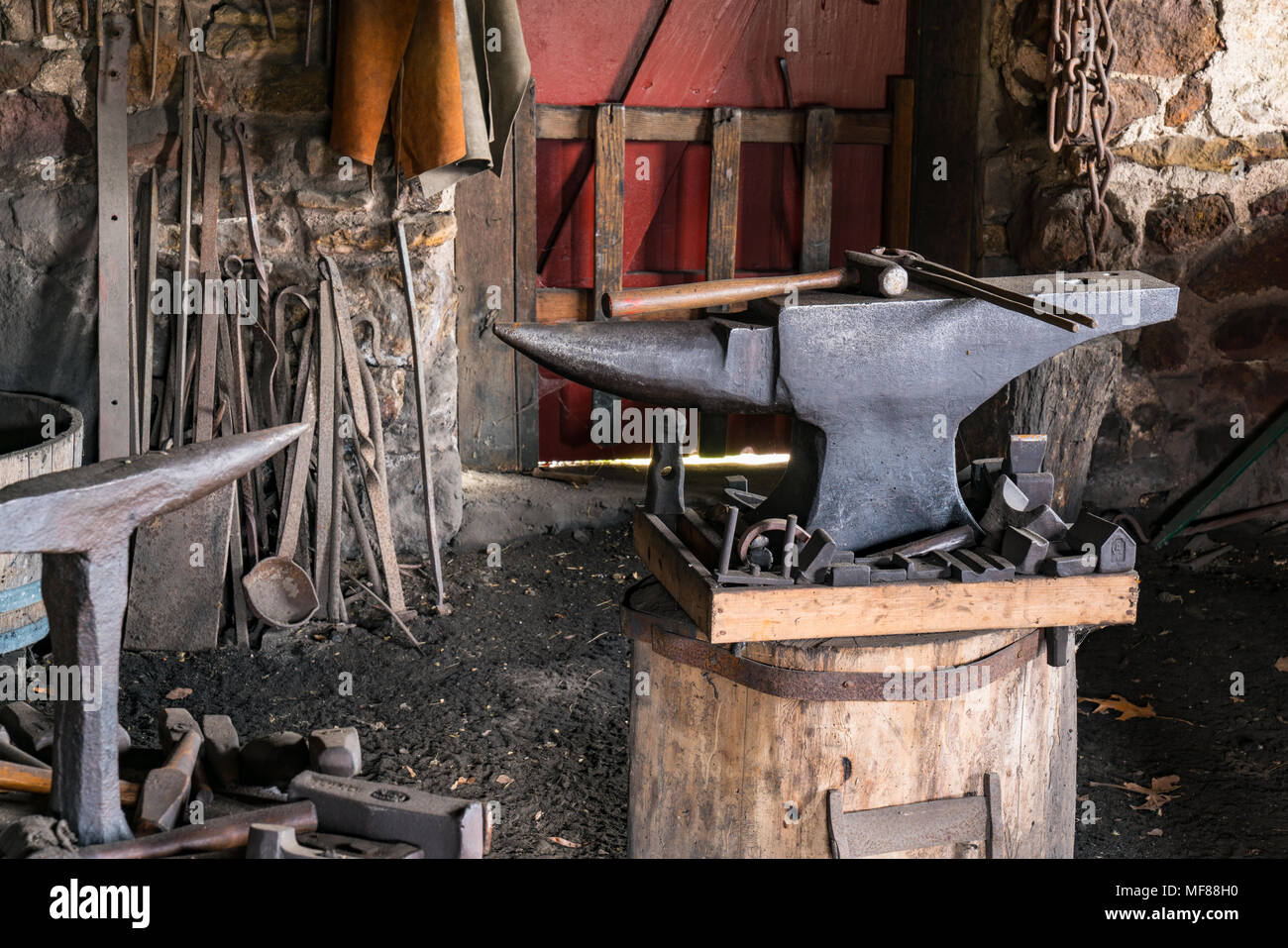 Iron Shop Tools On An Iron Anvil In An Old Blacksmiths Shop Stock Photo