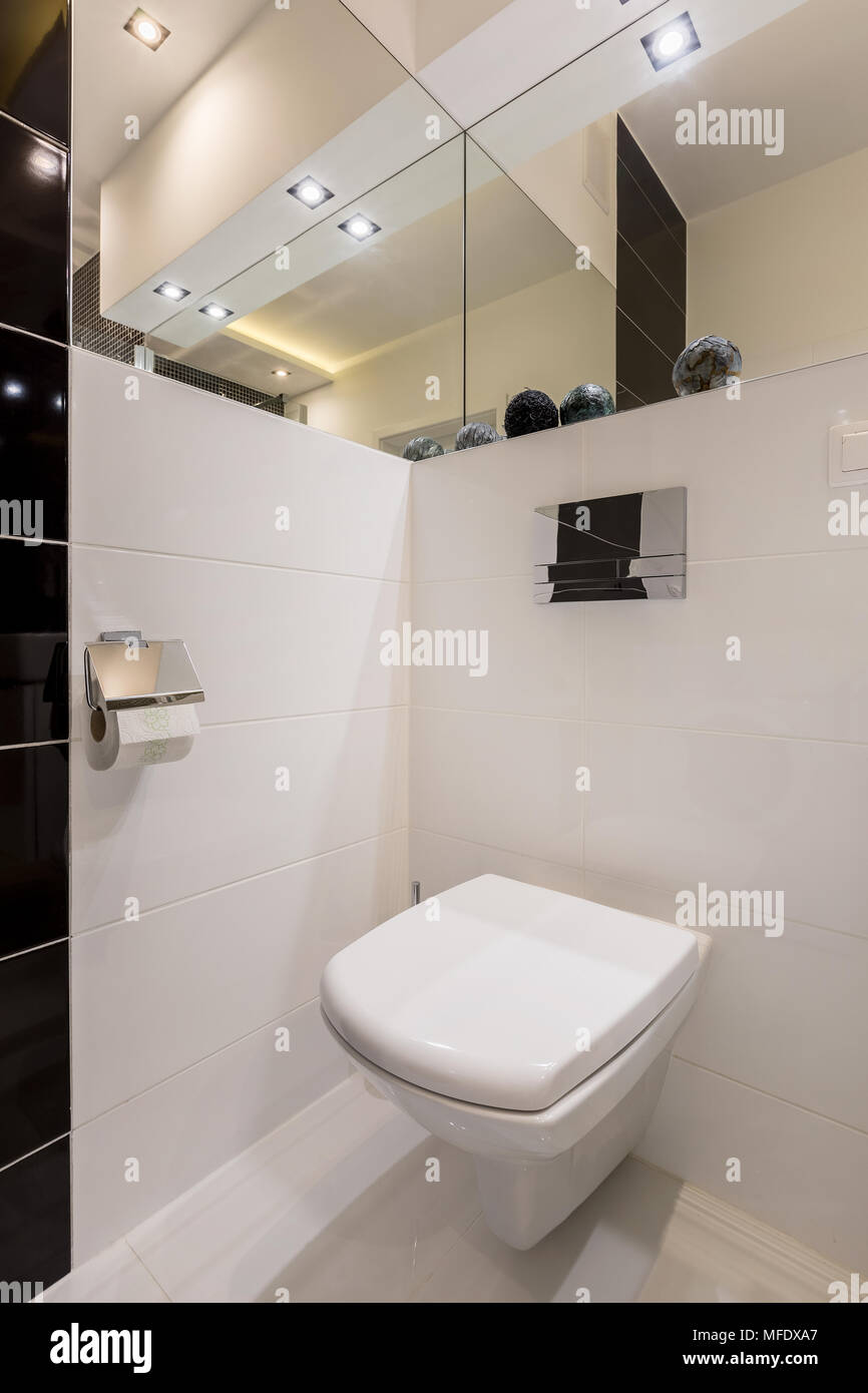 Bathroom With Mirrors White Toilet In Modern Bathroom With Mirrors And Led Lamps Stock