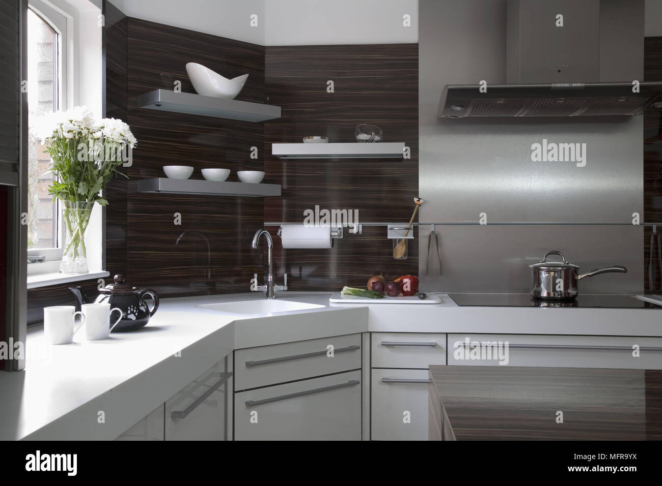 Stainless Steel Splashback Modern Kitchen With White Fitting Units And Stainless Steel