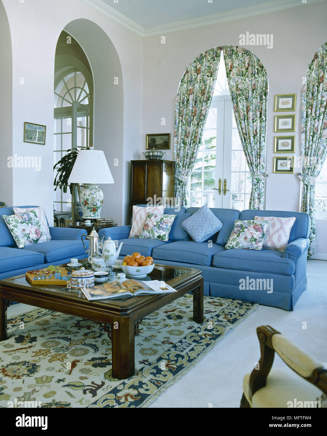 Draping Curtains Traditional Sitting Room With Upholstered Sofas Wood Coffee Table