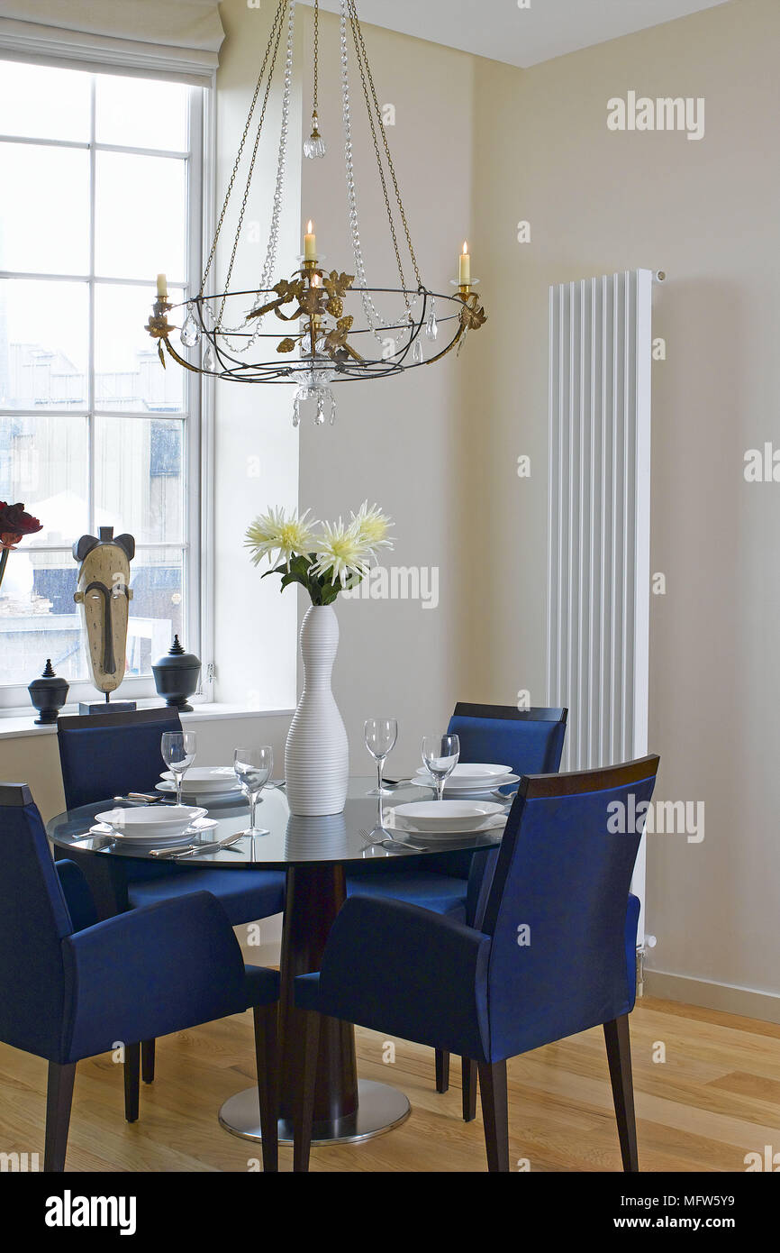 Wall Mounted Dinner Table Blue Upholstered Chairs Set Round A Dining Table Near A Window