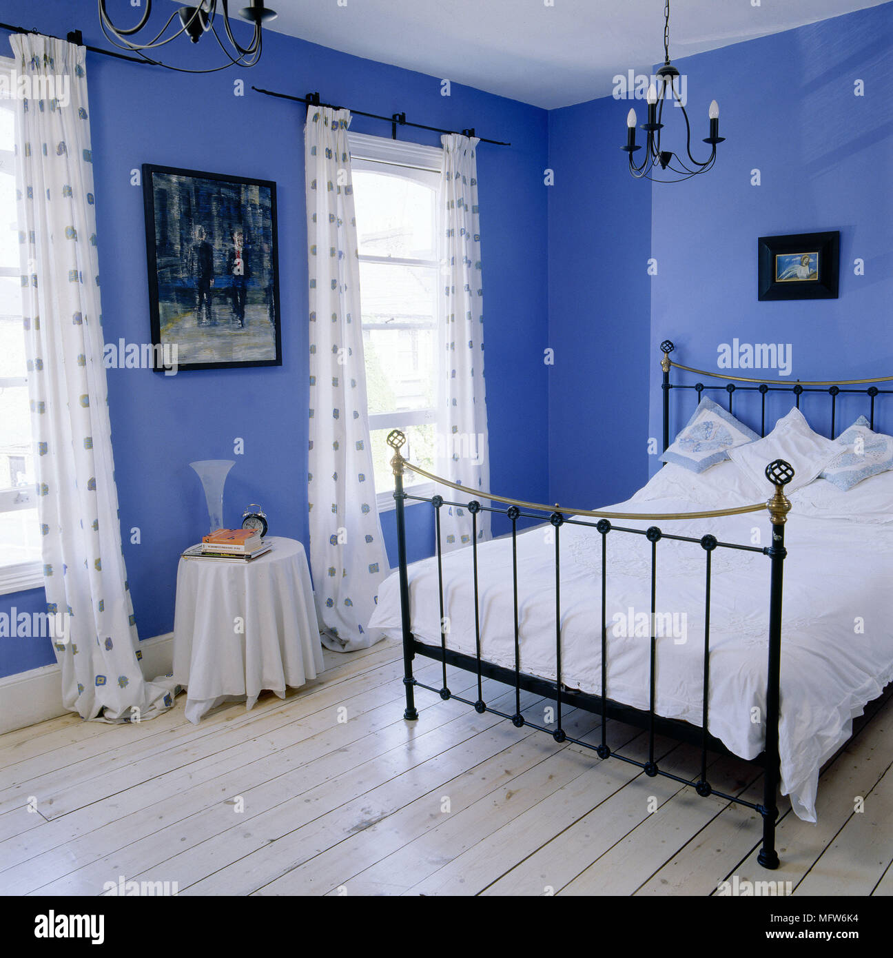 Black And Blue Curtains Modern Blue Bedroom With Stripped Floorboards Black Wrought Iron