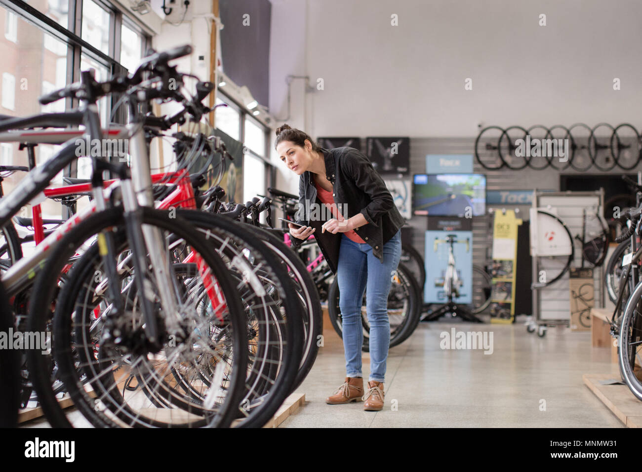 A Bike Store Small Business Owner Stock Taking In A Bike Store Stock Photo