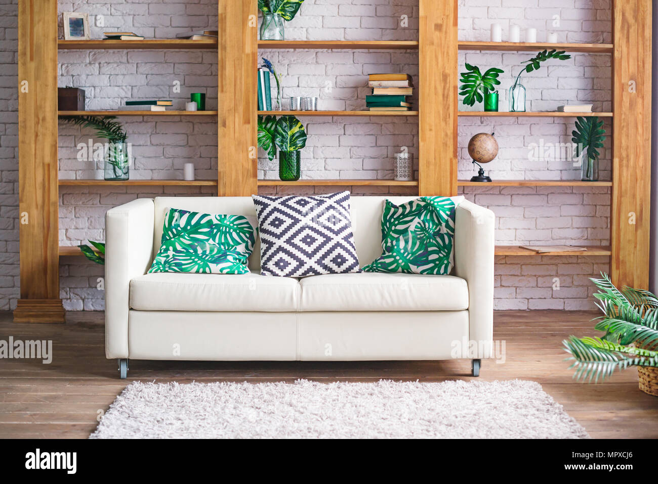 Stylish Furniture Cozy Light Room With Plants White Sofa And Stylish Furniture In