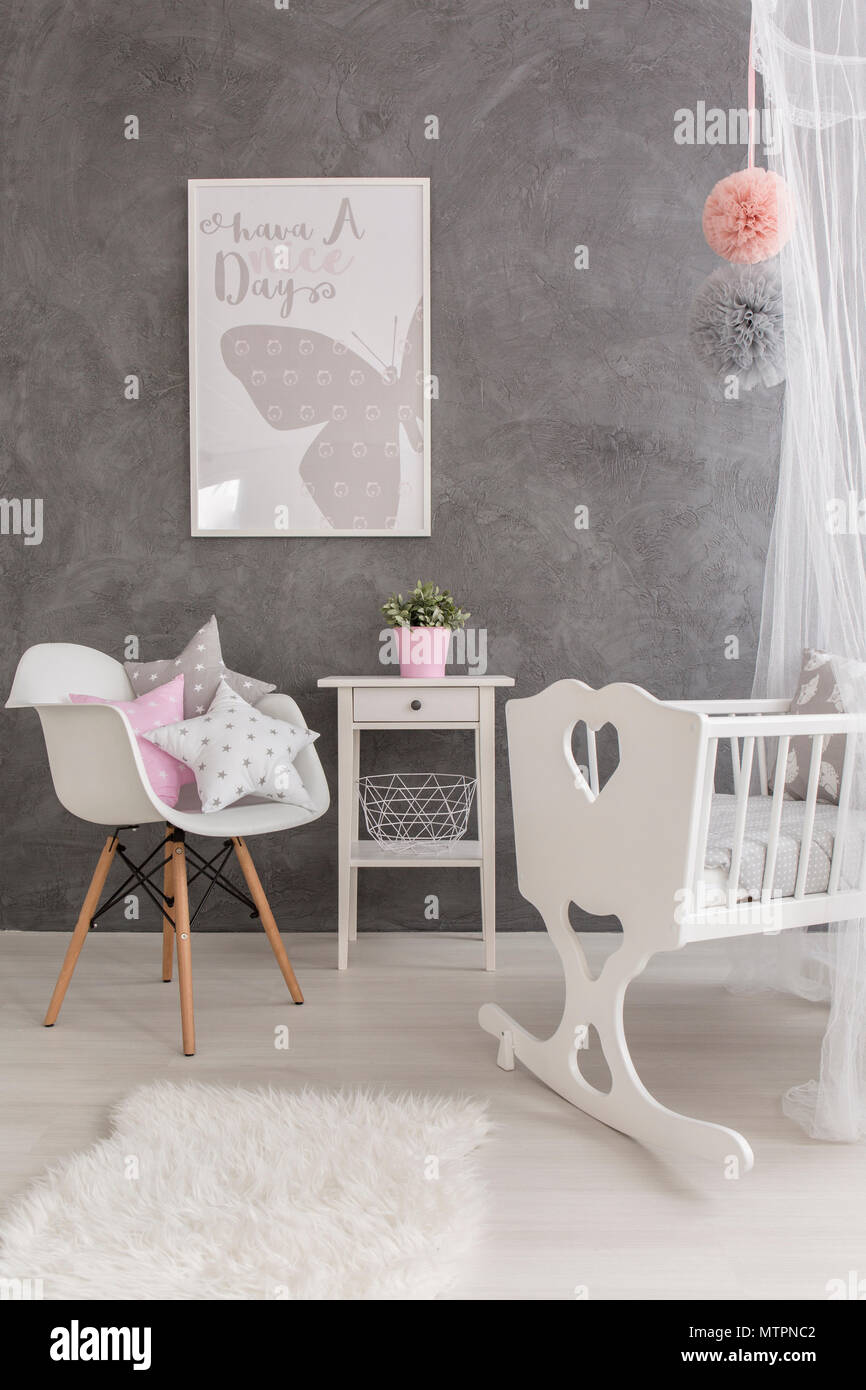 Babies Room Accessories Shot Of A Modern Grey Baby Room With White Accessories Stock Photo