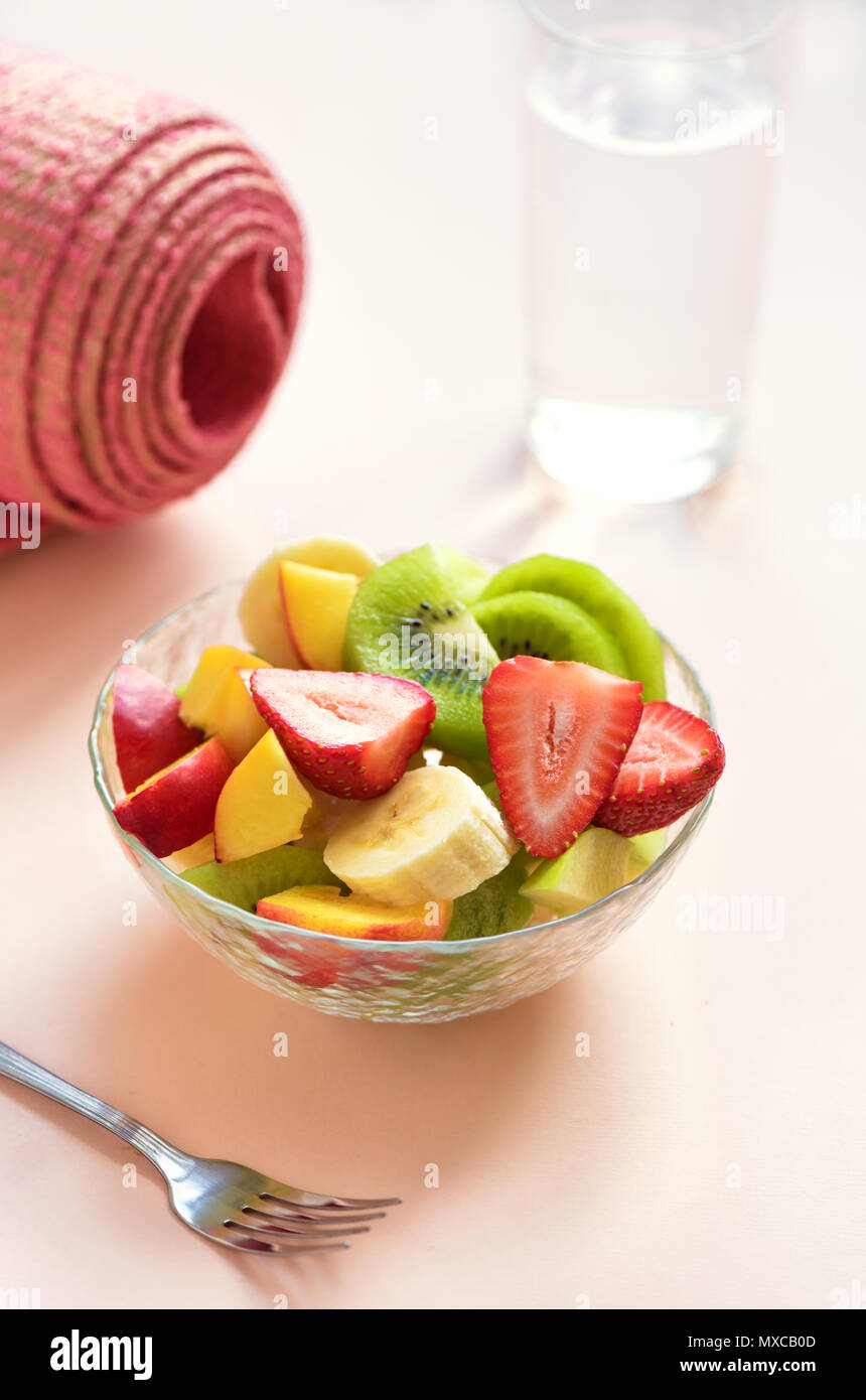 Bowl For Fruit Sport And Healthy Lifestyle Concept Pink Yoga Mat And Fruit And
