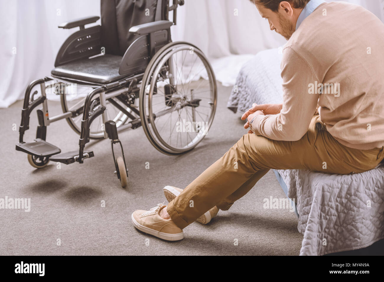 Bed Wheelchair Sad Man With Disability Sitting On Bed Wheelchair Standing Near