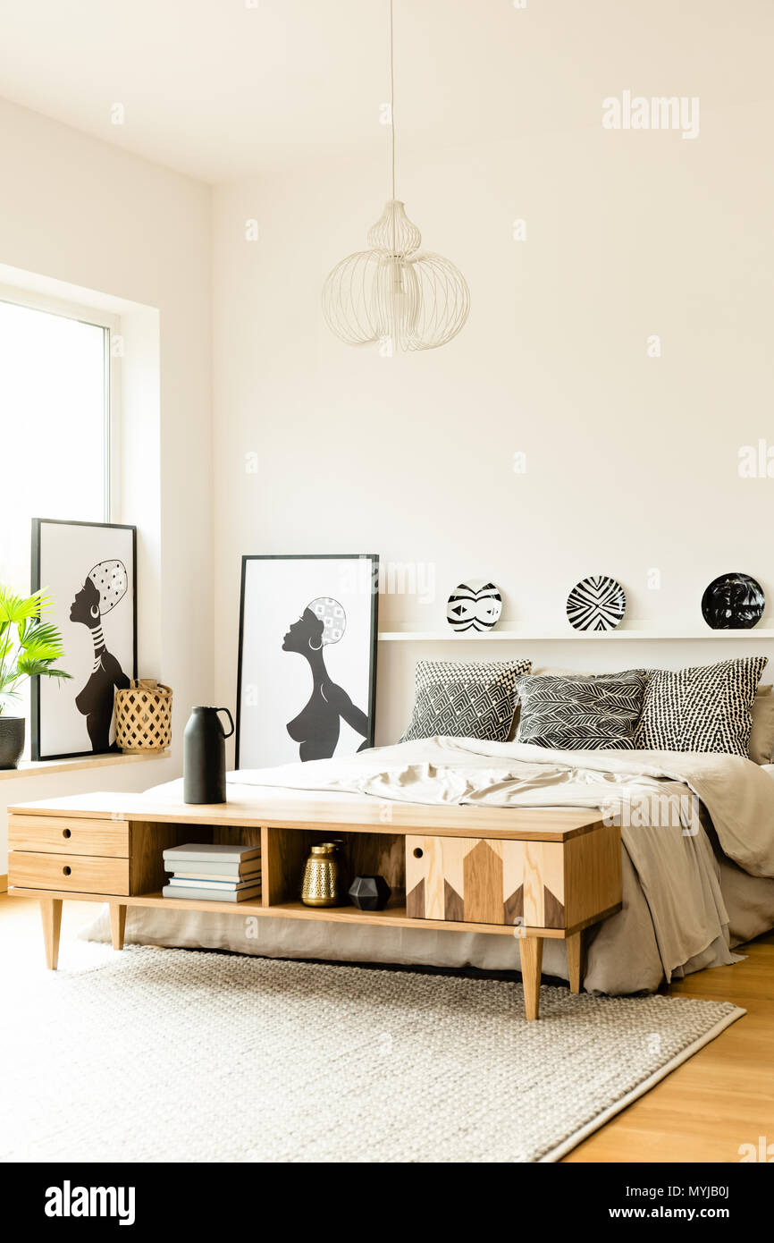 Boho Bedroom Patterned Plates Above Bed In Boho Bedroom Interior With Posters