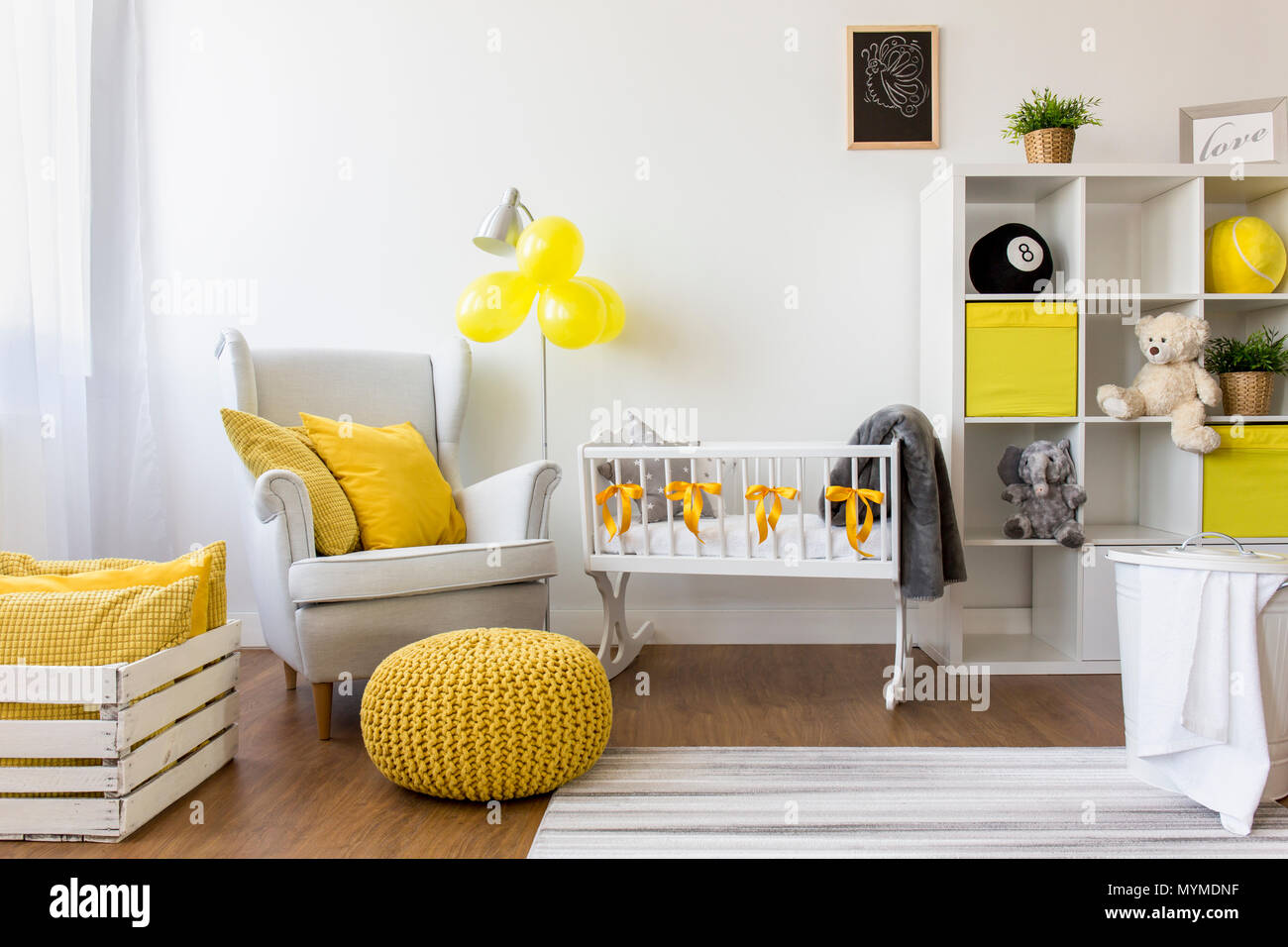 Babies Room Accessories Shot Of A Modern Cozy Baby Room With Yellow Accessories Stock