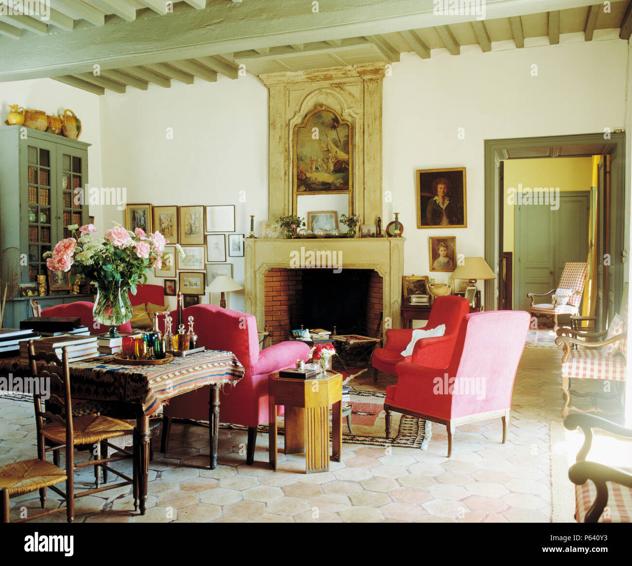 French Country Fireplace Red Armchairs Set Around Fireplace With Pictorial Overmantel In