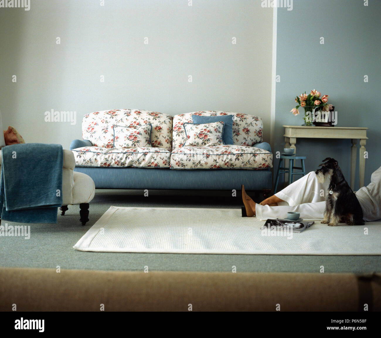 Grey White And Blue Living Room Floral And Blue Sofa In Modern Grey Living Room With Man S Legs