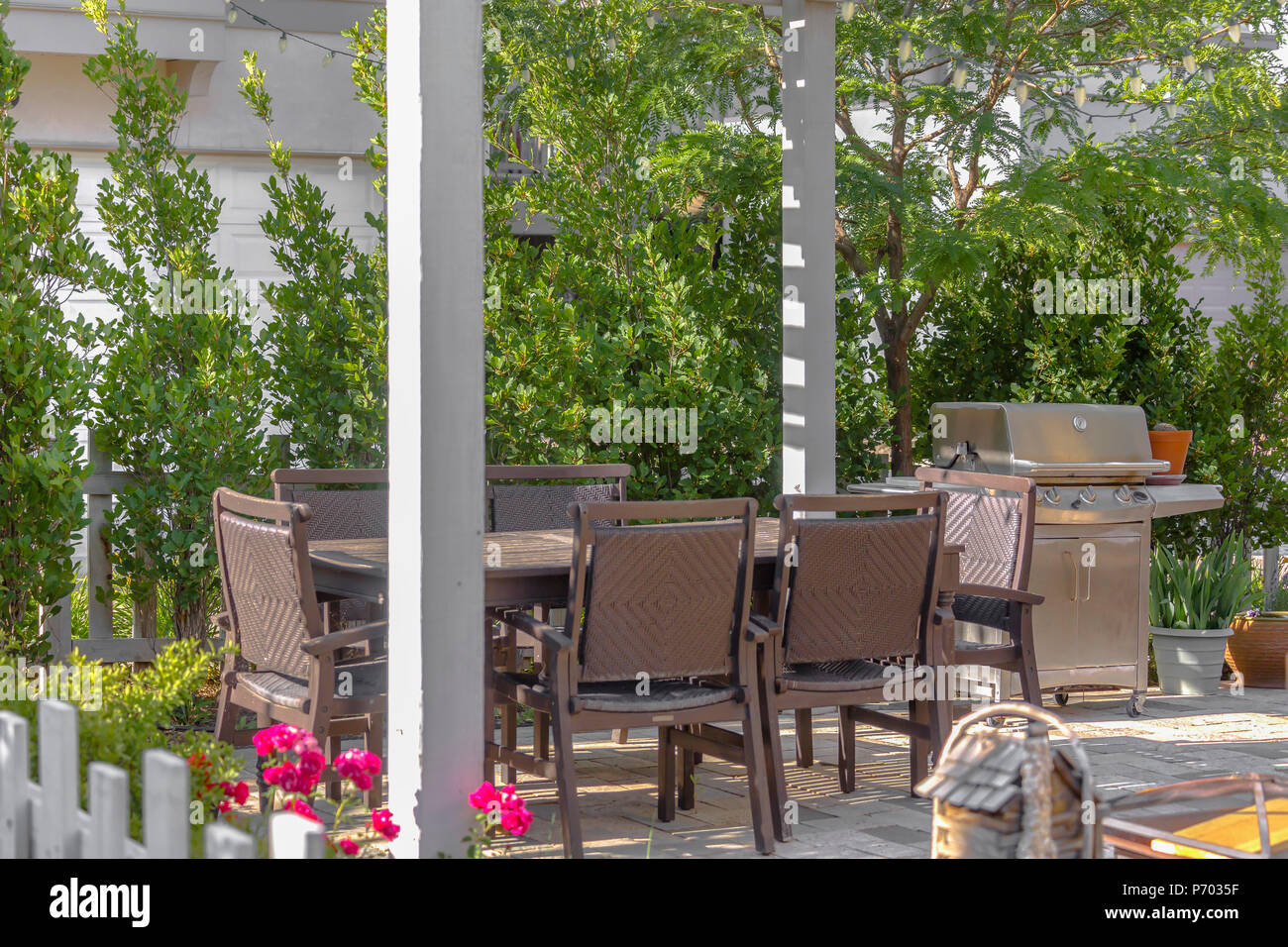 Backyard Chairs Patio Chairs And Bbq Outside Stock Photo 210829515 Alamy