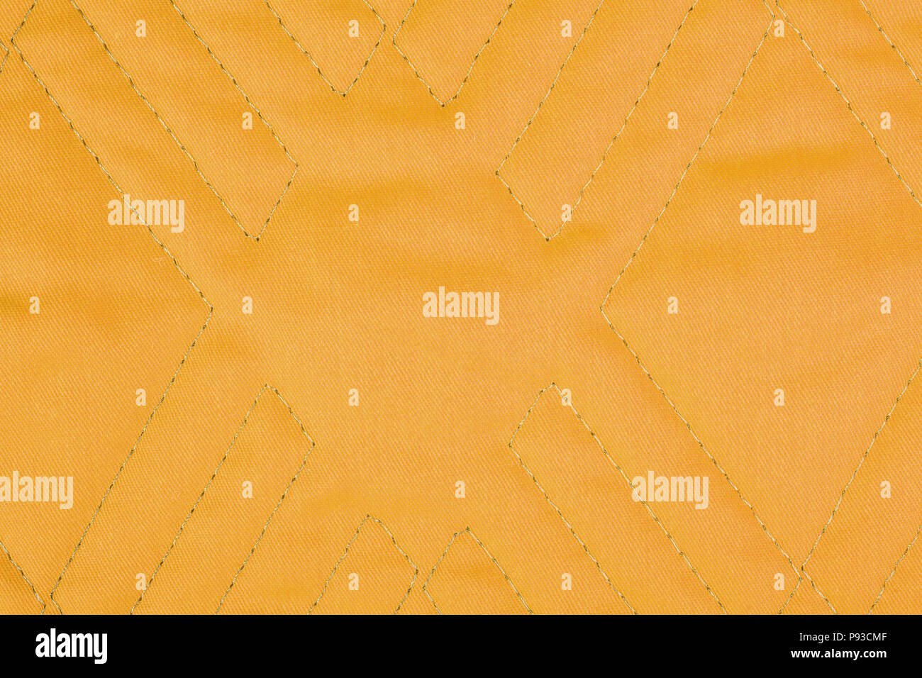 Quilted Fabric Orange Quilted Fabric Texture With Geometric Pattern Stock Photo