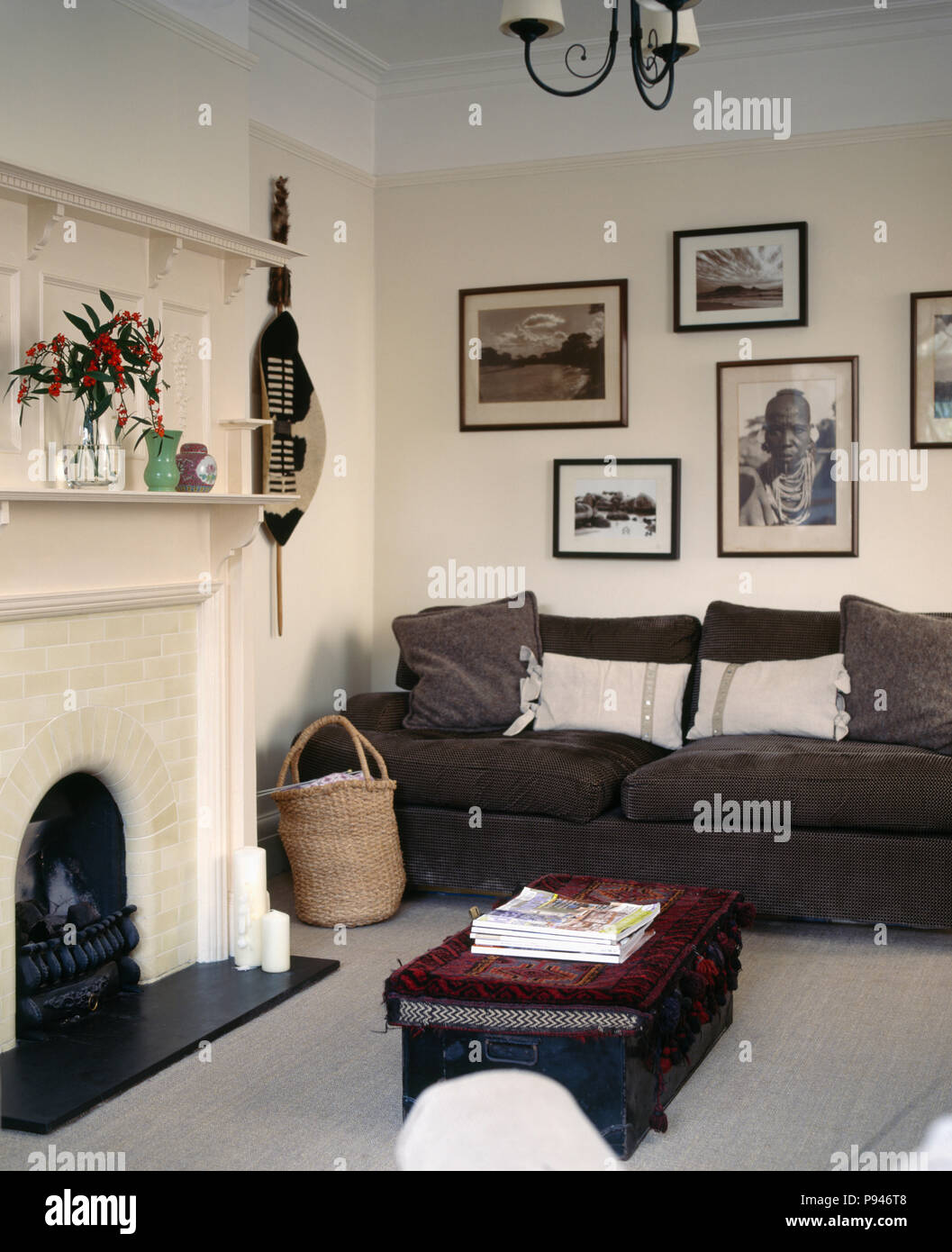 Living Room With Grey Sofa Black White African Photographs Above Dark Grey Sofa In Cream