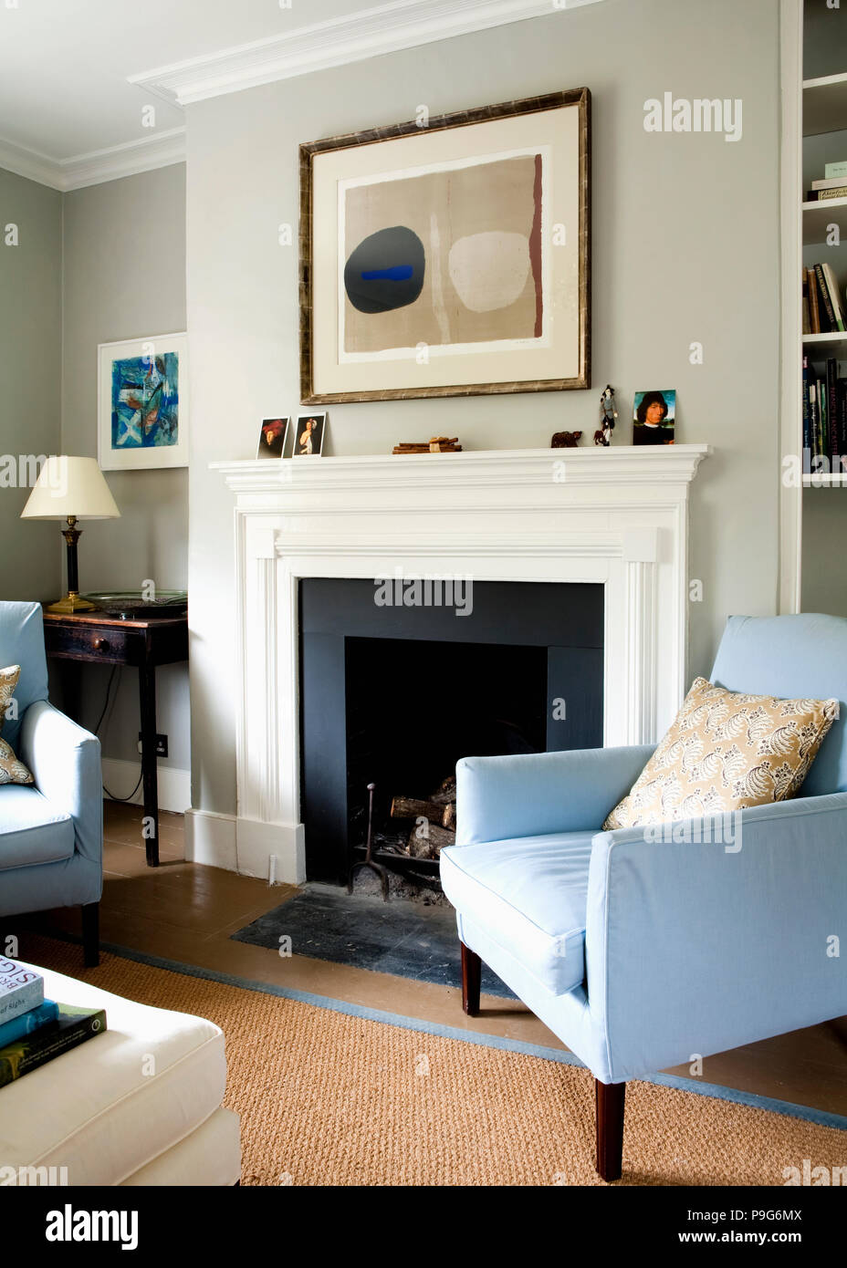 Grey White And Blue Living Room Large Abstract Painting Above White Fireplace In Pale Grey Living
