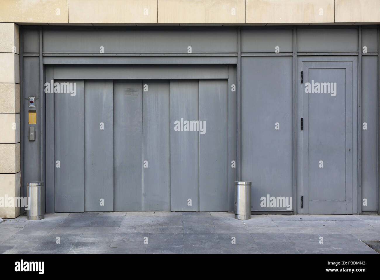 Car Lift And Garage Door Entrance To Underground Car Garage With Elevator Lift Stock Photo