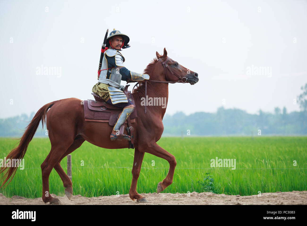 Asian Thai Warrior In Traditional Armor Suit Riding Horse