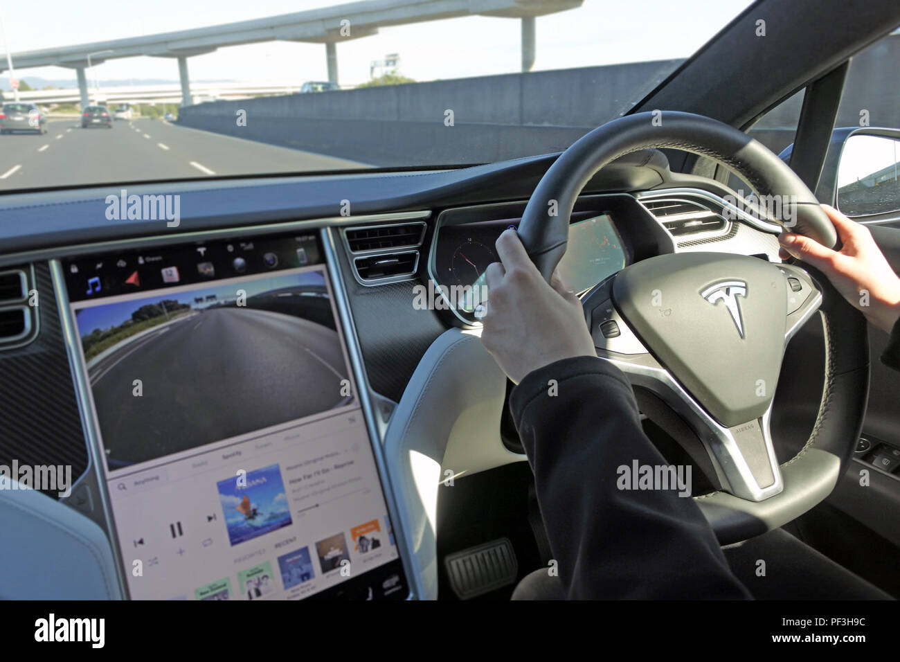Cuv Car Person Driving A Tesla Plug In Electric Car Model X A Luxury