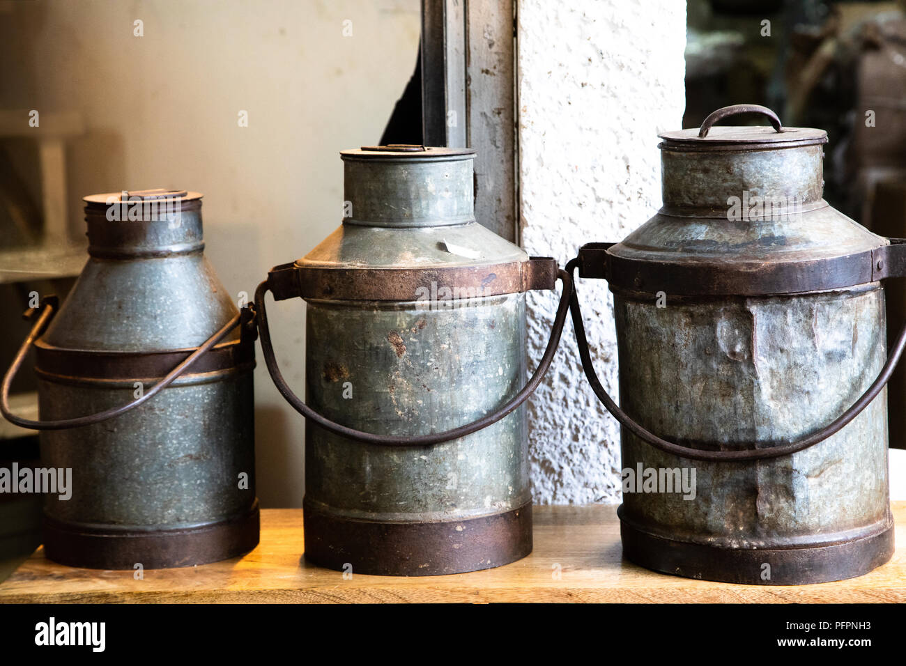 Decorative Milk Urn Display Of 3 Decorative Metal Milk Churns Stock Photo