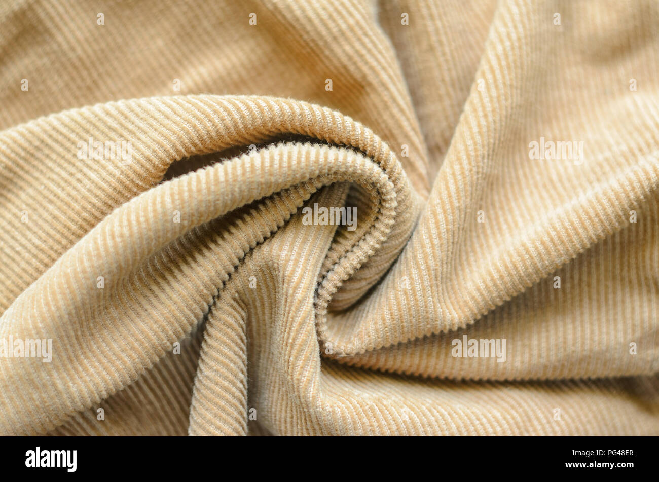 Texture Of Soft Velvet Fabric With Folds Closeup Texture Of Beige Velvet Clothes Textile Fabric Of Corduroy As Background Stock Photo Alamy