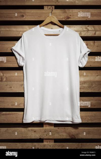Blank white t-shirt hanging on the wooden background, with copy space Stock Photo: 218385107 - Alamy