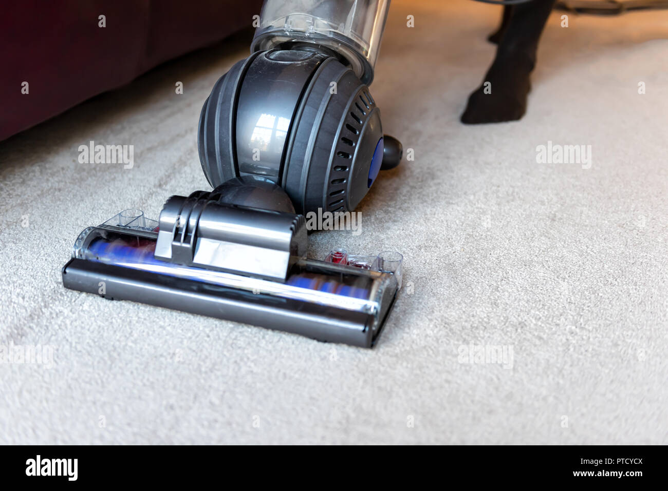 Sofa Vacuum Cleaner Brush Closeup Of Woman Doing Cleaning At Home With Vacuum Cleaner
