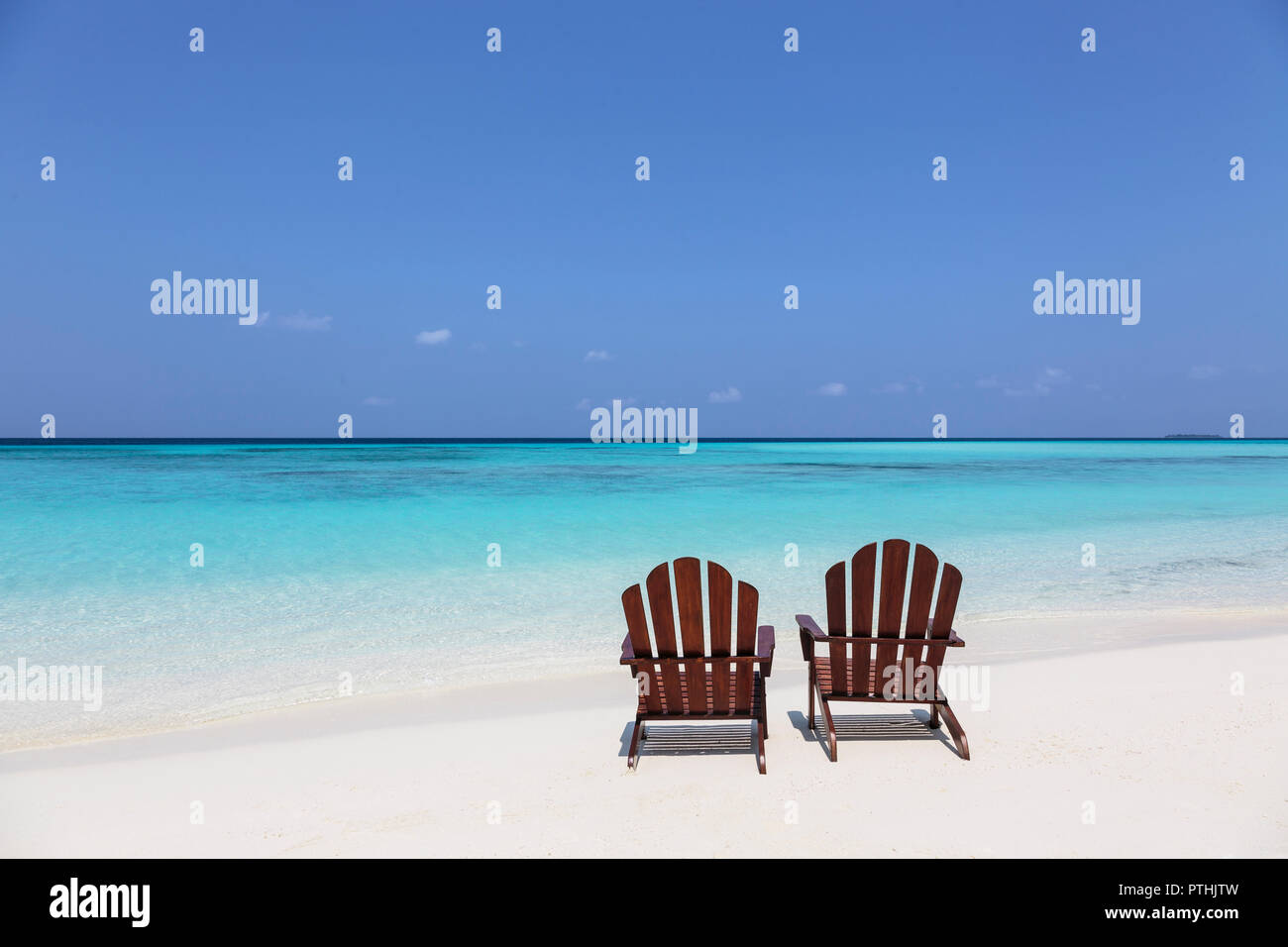 Two Adirondack Chairs On Sunny Tranquil Beach Overlooking Blue Ocean Maldives Indian Ocean Stock Photo Alamy