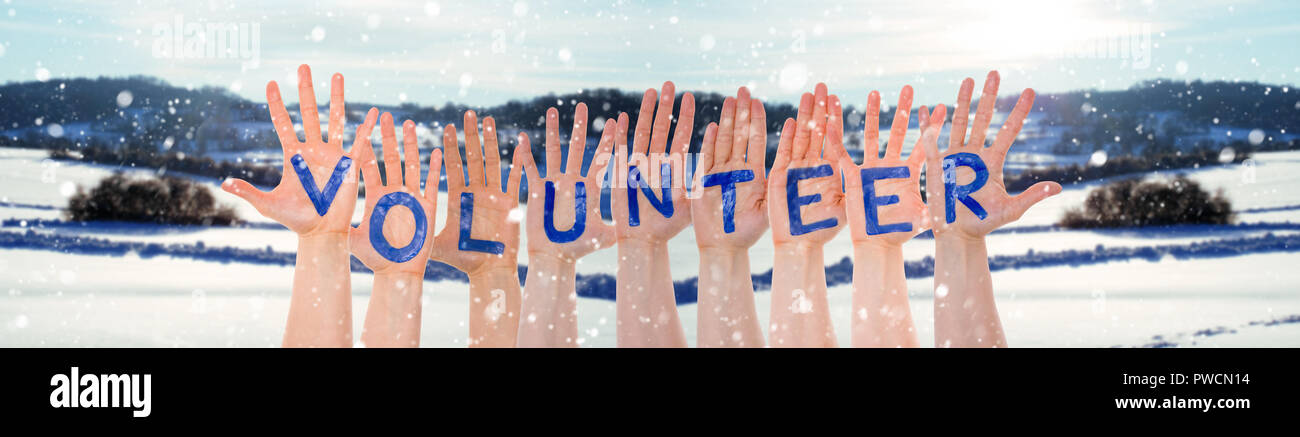 Many Hands Building Word Volunteer, Winter Scenery As Background