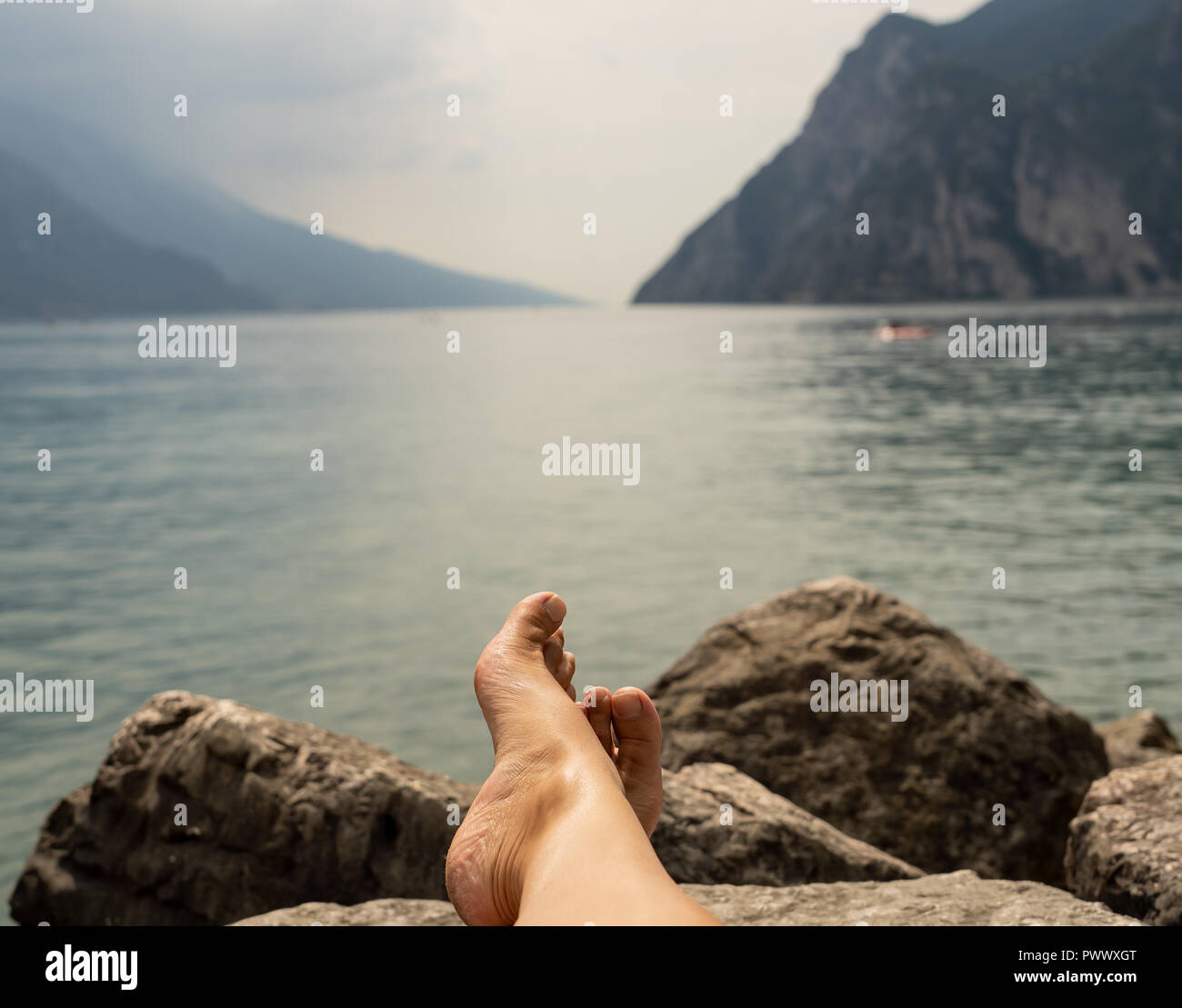 Relax Fh Rt Close Up Feet Of Woman Relaxing By A Beautiful Big Lake Lying On