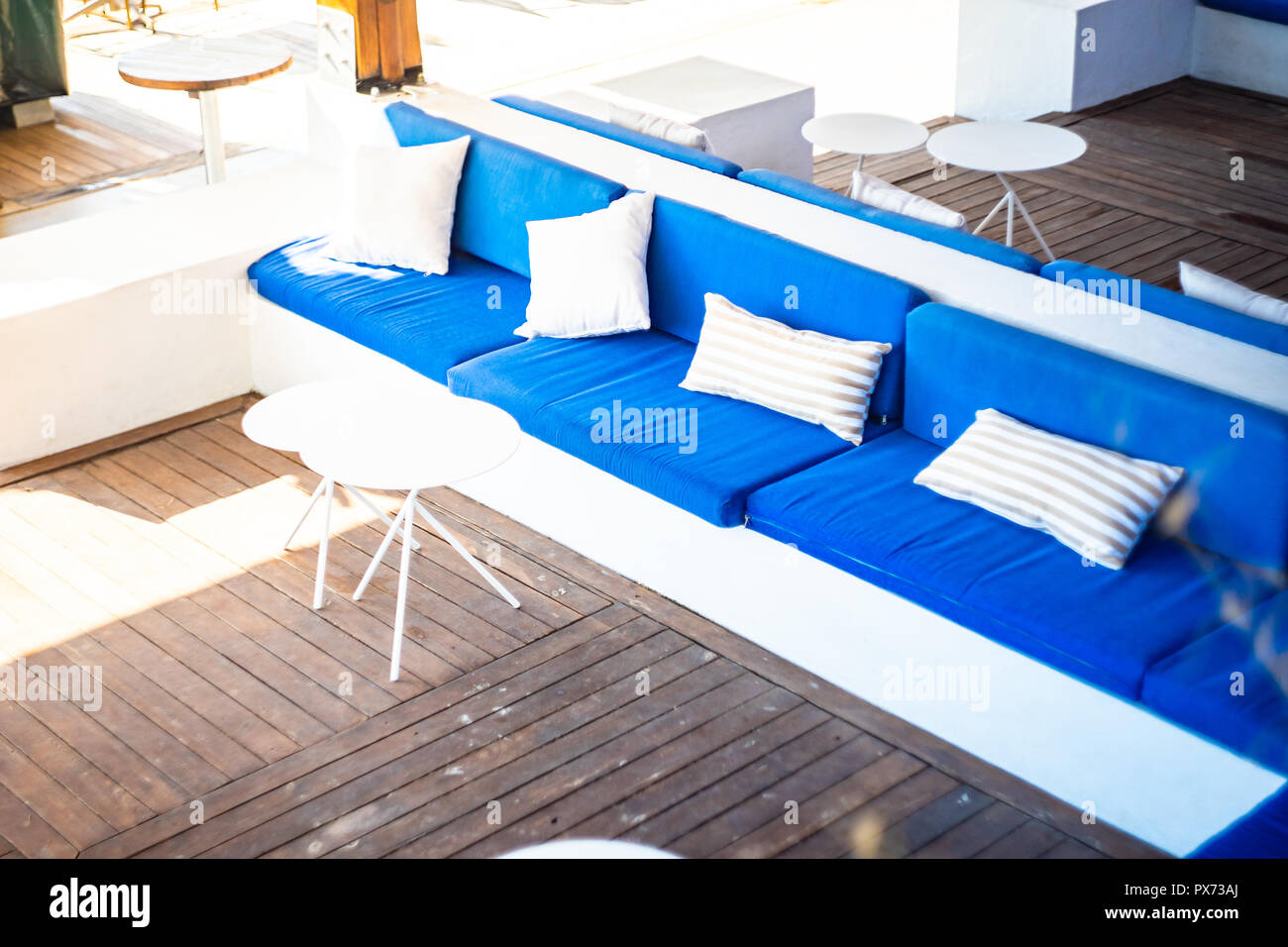 Blue Lounge Beachside Lounge Zone With Blue And White Sofas Stock Photo